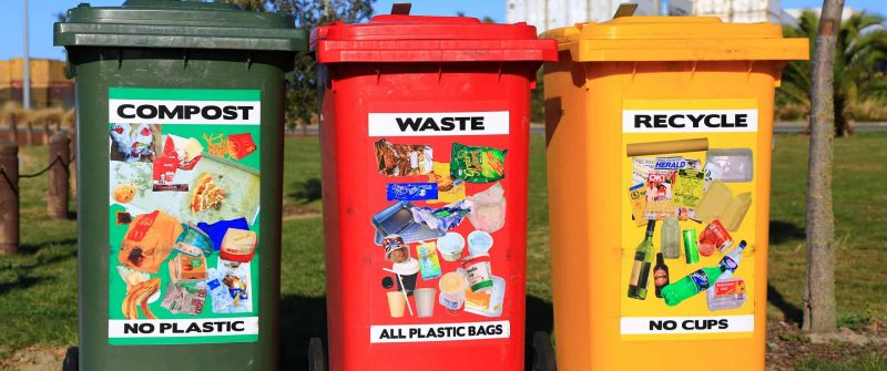 green bin for compost, red bin for waste and yellow bin for recycling